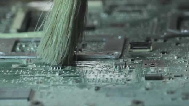 Dusting Off Laptop Motherboard: Stock Video