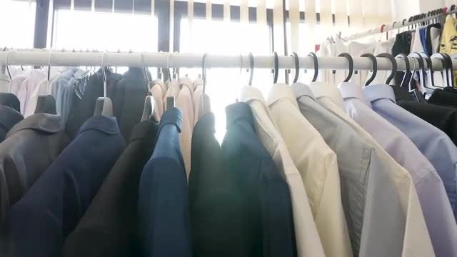 Cloth Rack With Clothes Hanging: Stock Video