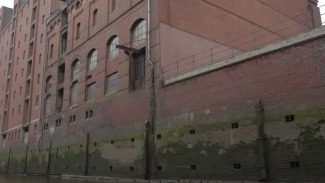 Sailing By Brick Industrial Buildings: Stock Video