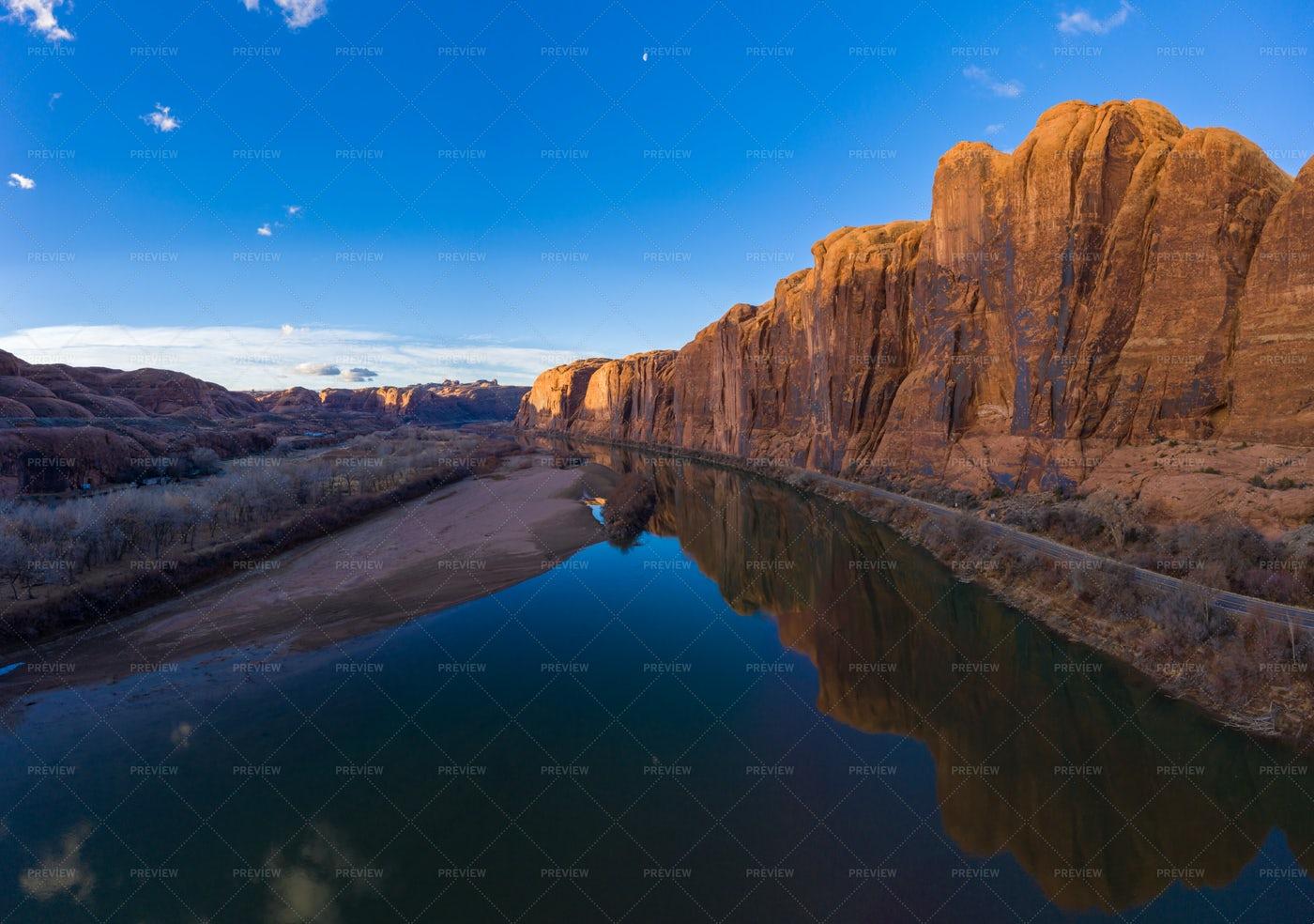 Colorado River And Red Sandstone Cliffs: Stock Photos