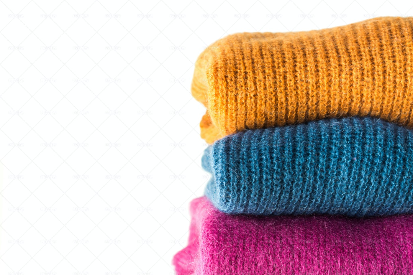 Pile Of Woolen Sweaters: Stock Photos