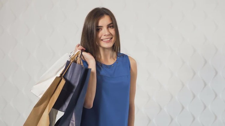 Happy Girl Carrying Shopping Bags: Stock Video