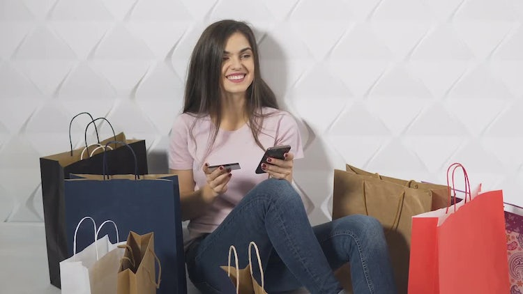 Happy Girl Doing Online Shopping: Stock Video