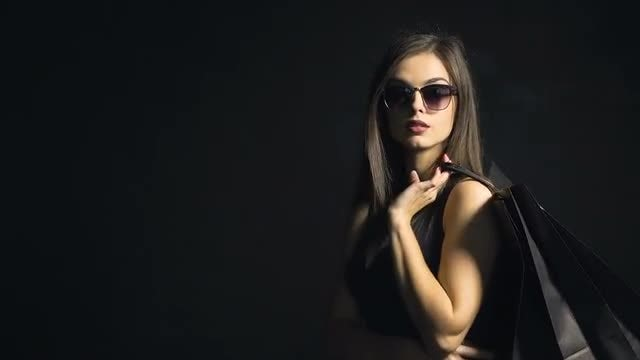 Sophisticated Girl With Shopping Bag: Stock Video