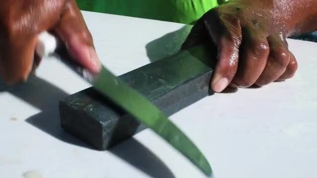 Man Sharpening A Knife: Stock Video