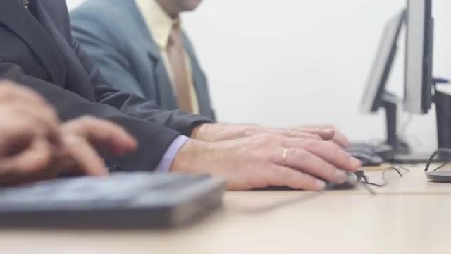 Men Working On Computers: Stock Video