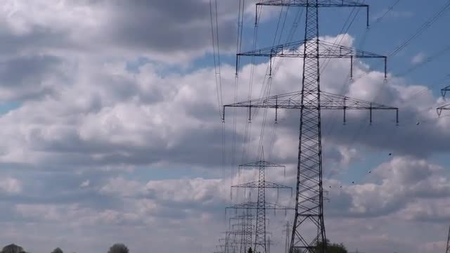 Electric Poles Against Clouds: Stock Video