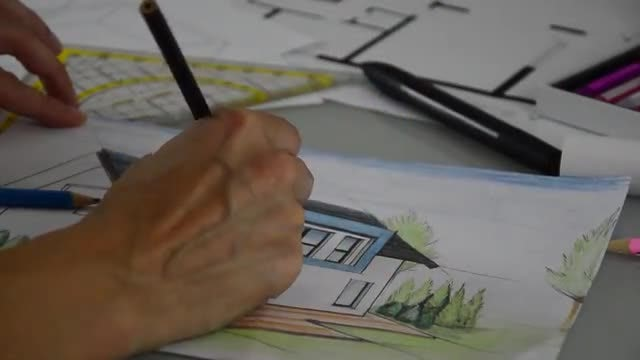 Architect Coloring The House Plan: Stock Video
