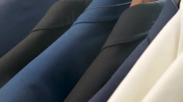 Male Business Clothes On Rack: Stock Video