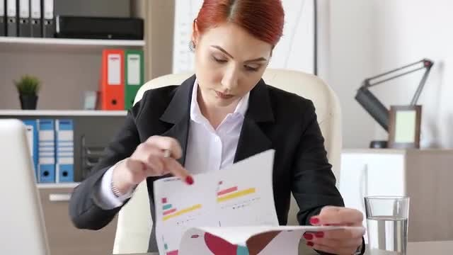 Businesswoman Signing Documents: Stock Video