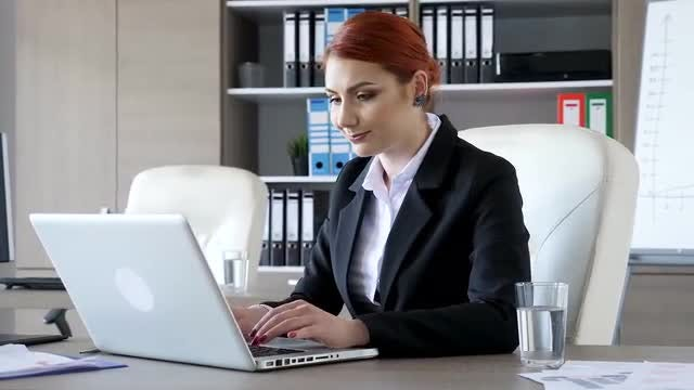 Smiling Businesswoman In Office Working: Stock Video