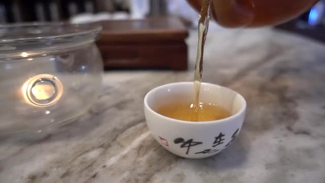 Slow Motion Pouring Chinese Tea: Stock Video