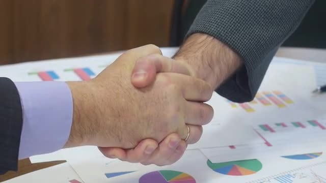 Business Partners Shaking Hands: Stock Video