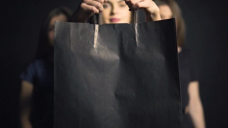Girl Shows Black Shopping Bag: Stock Video