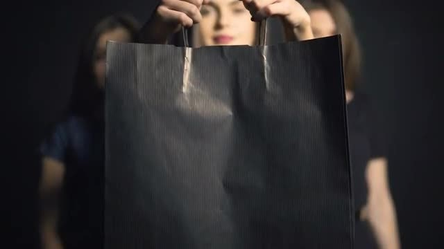 Girl Shows Black Shopping Bag: Stock Video