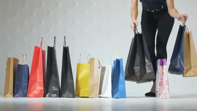 Girls Take Shopping Bags: Stock Video