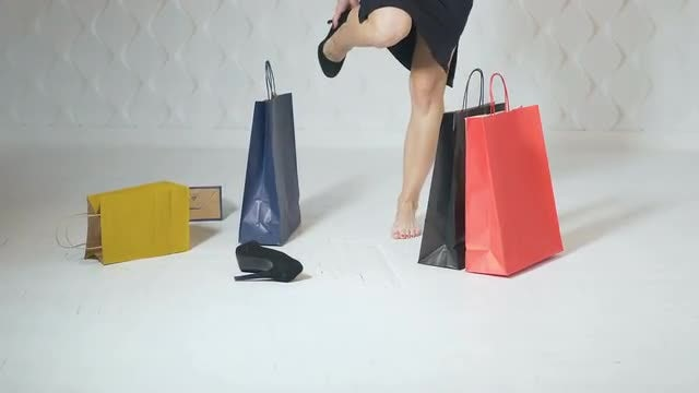 Girl Dropping Shopping Bags: Stock Video