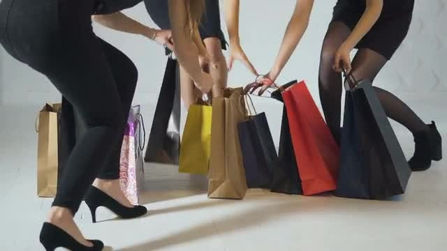 Girls Grabbing Shopping Bags : Stock Video