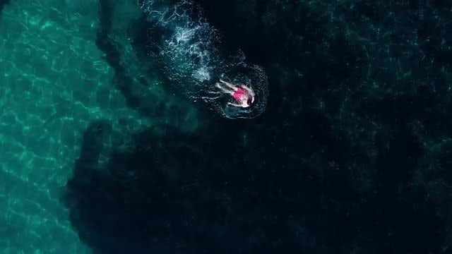 Young Man Swimming In Sea: Stock Video
