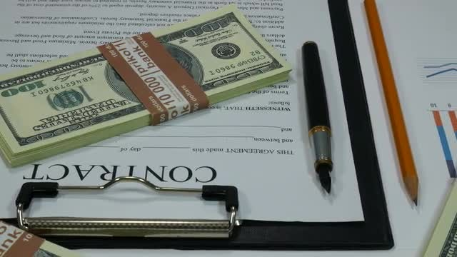 Business Contract And Dollar Bills: Stock Video