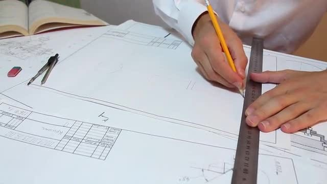 Architect Drawing With Yellow Pencil: Stock Video