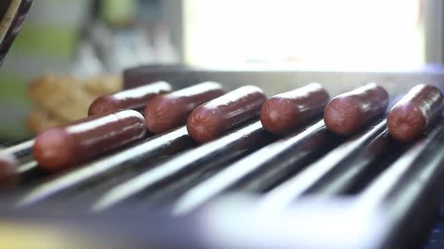 Sausages Frying On A Grill: Stock Video