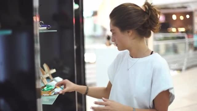 Woman Choosing Shoes: Stock Video