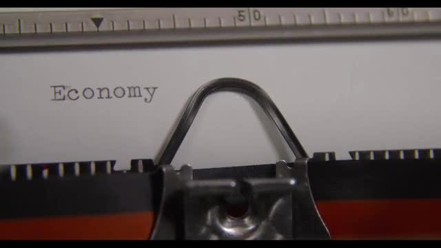 Typing The Word ECONOMY : Stock Video