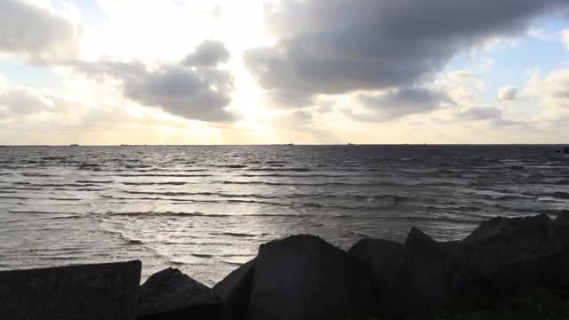 Silhouetted Shore During Sunset: Stock Video