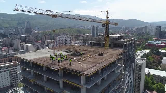 Tilting Shot Of Unfinished Building: Stock Video