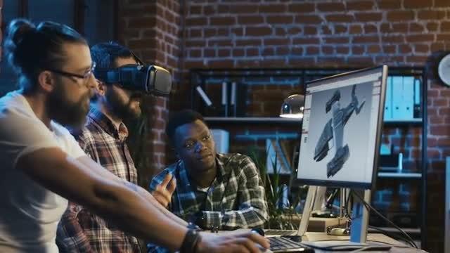 Men Creating 3D Video Game: Stock Video