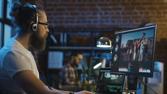 Man Editing Video In Studio: Stock Video