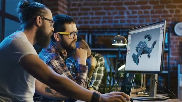 Men Creating 3D Video Game: Stock Video