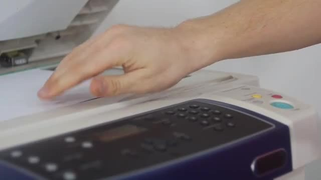 Man Using A Photocopier: Stock Video