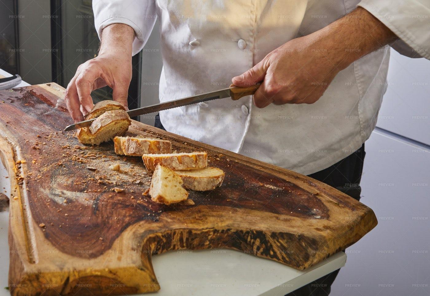Cutting Italian Bread: Stock Photos