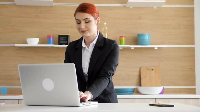 Woman Brings Her Laptop In Kitchen: Stock Video