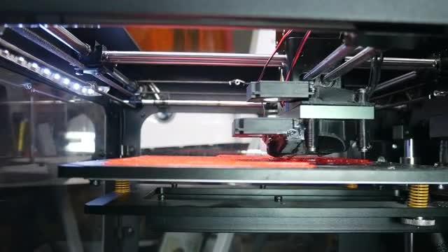 Large 3D Printer Printing Figurine: Stock Video
