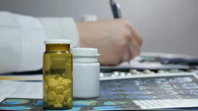 Doctor Dispensing Medication Prescription: Stock Video