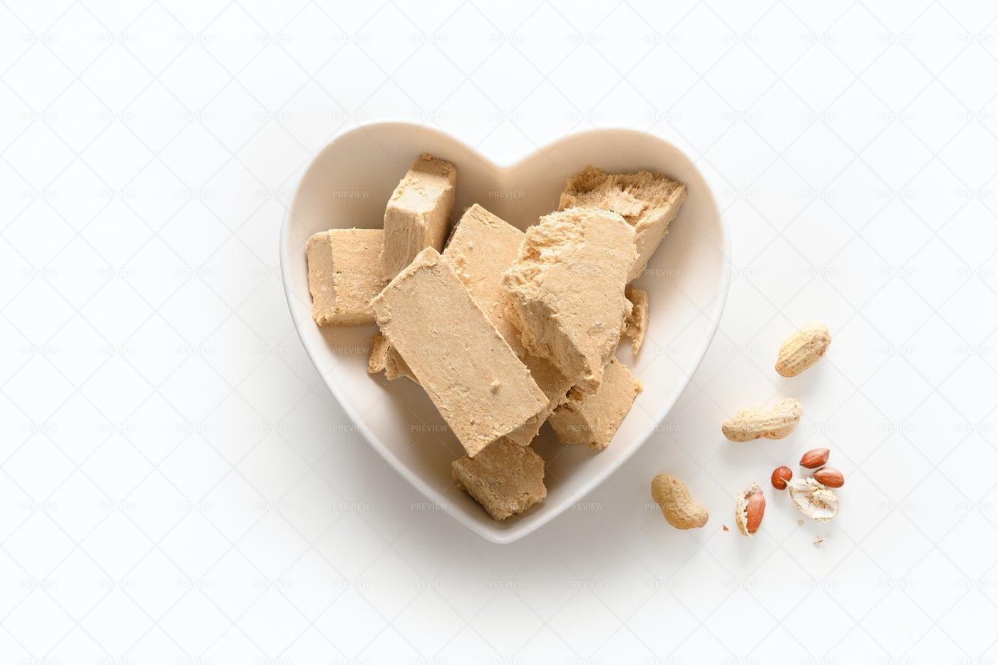 Sweet Dessert Peanuts Halva On White Bac: Stock Photos