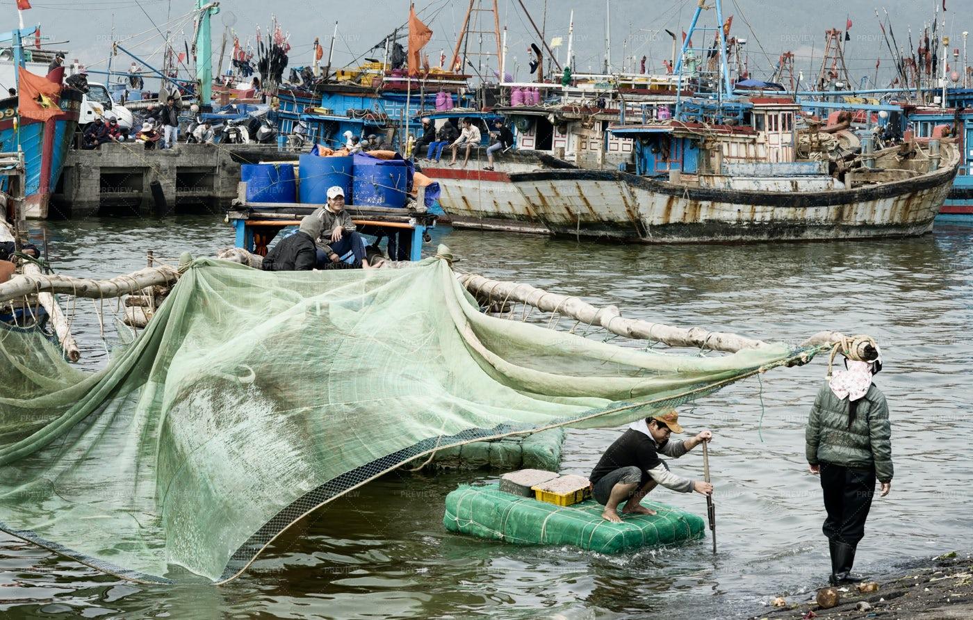 Fisherman Bringing Baskets With Shrimps: Stock Photos