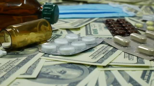 Prescription Drugs And Dollar Bills: Stock Video