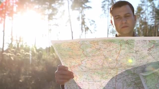 Young Man Looking at a Map: Stock Video