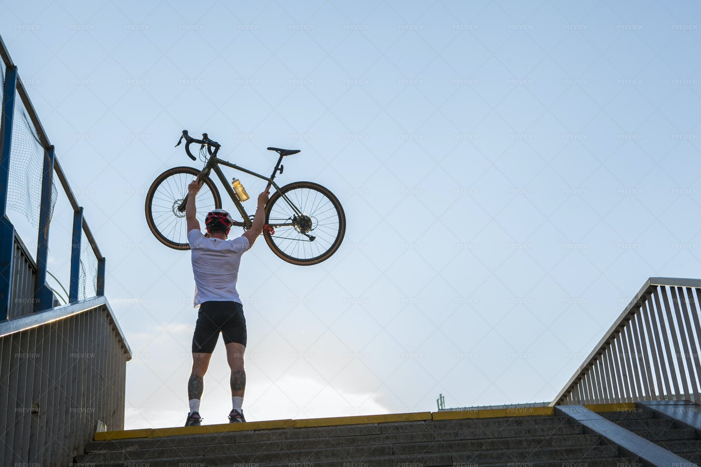 Lifting Bicycle In The Air: Stock Photos