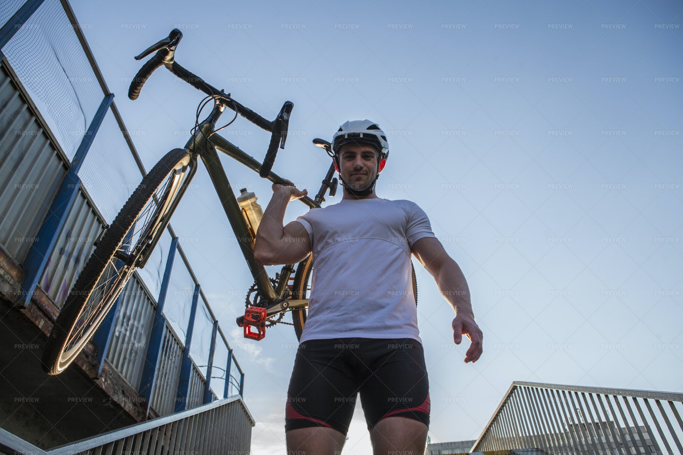 Cheerful Cyclist Carrying Bike: Stock Photos