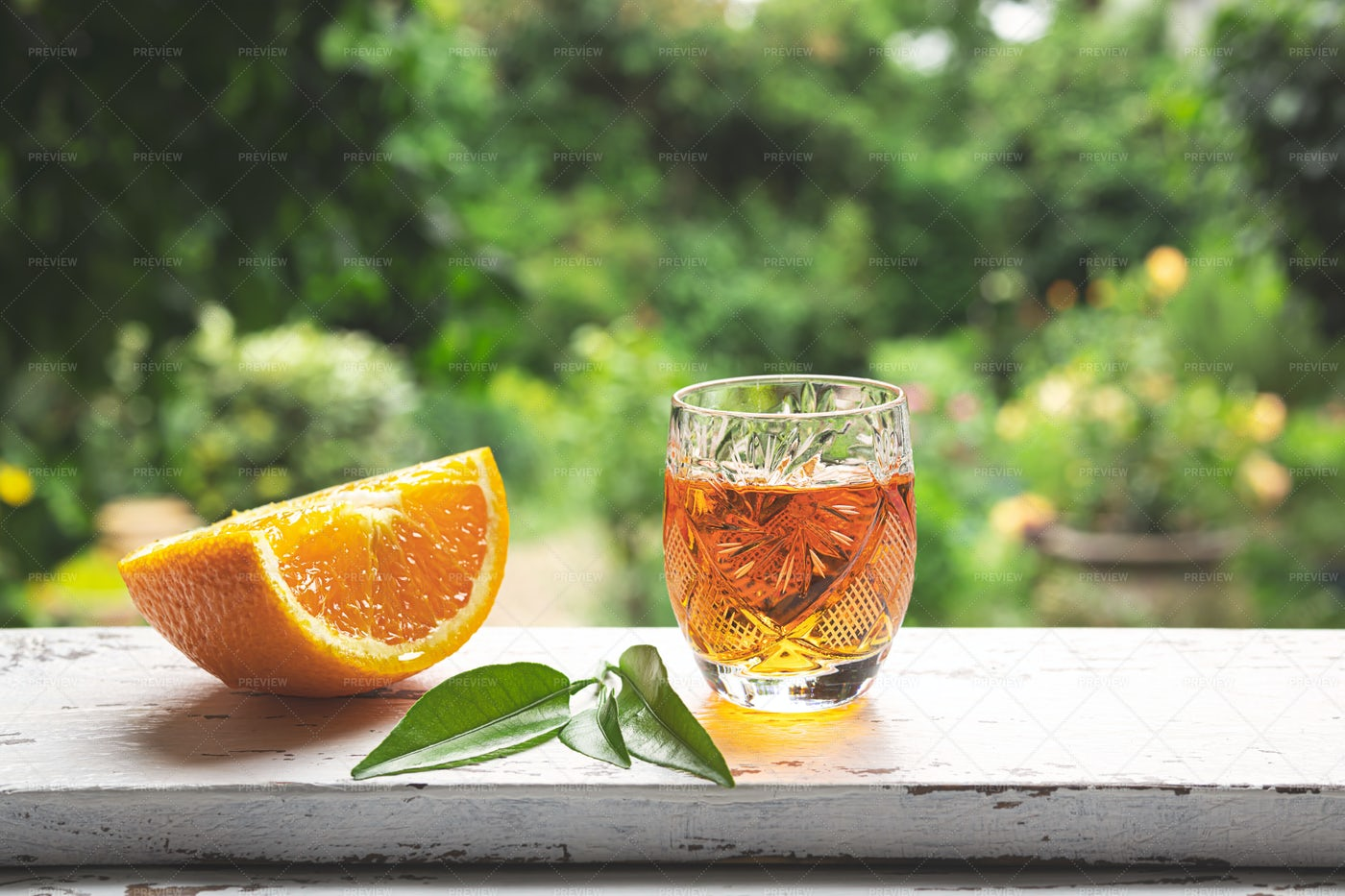 Tangerine Liqueur On A Windowsill: Stock Photos