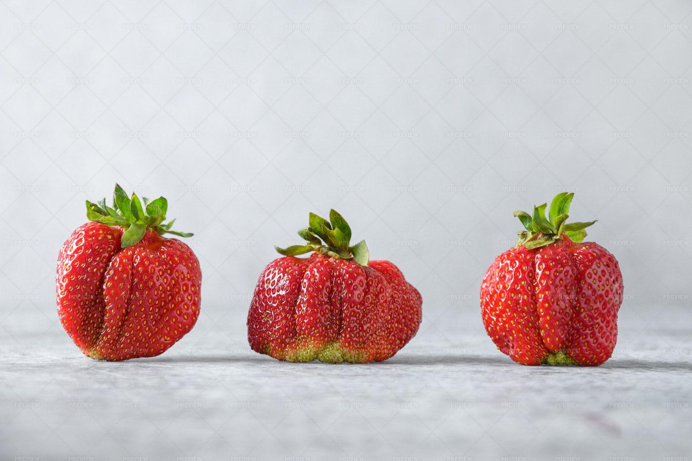 Fresh Ugly Strawberry: Stock Photos