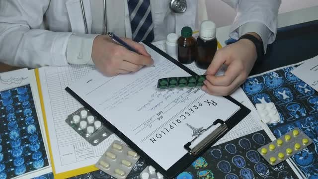 Male Doctor Prescribing Drugs: Stock Video