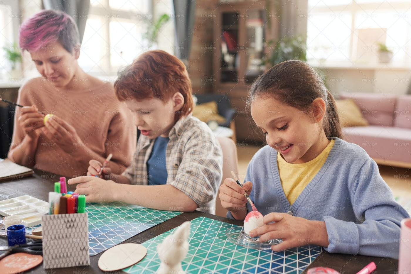 Family Painting Eggs For Easter: Stock Photos