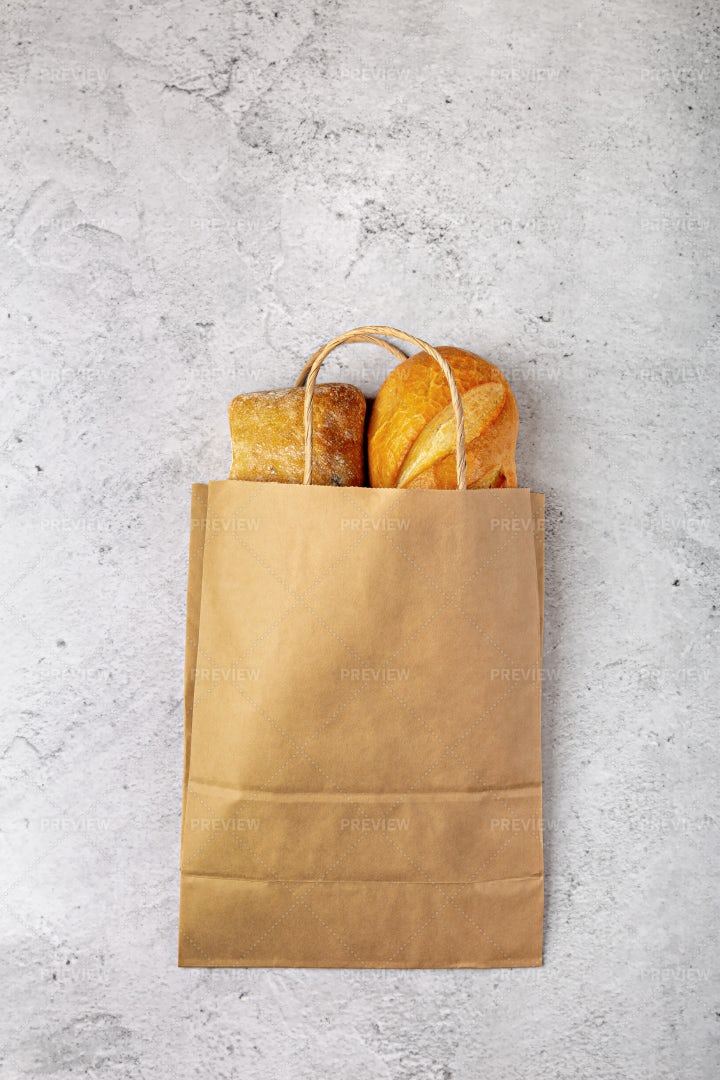 Disposable Paper Bag With Bread: Stock Photos