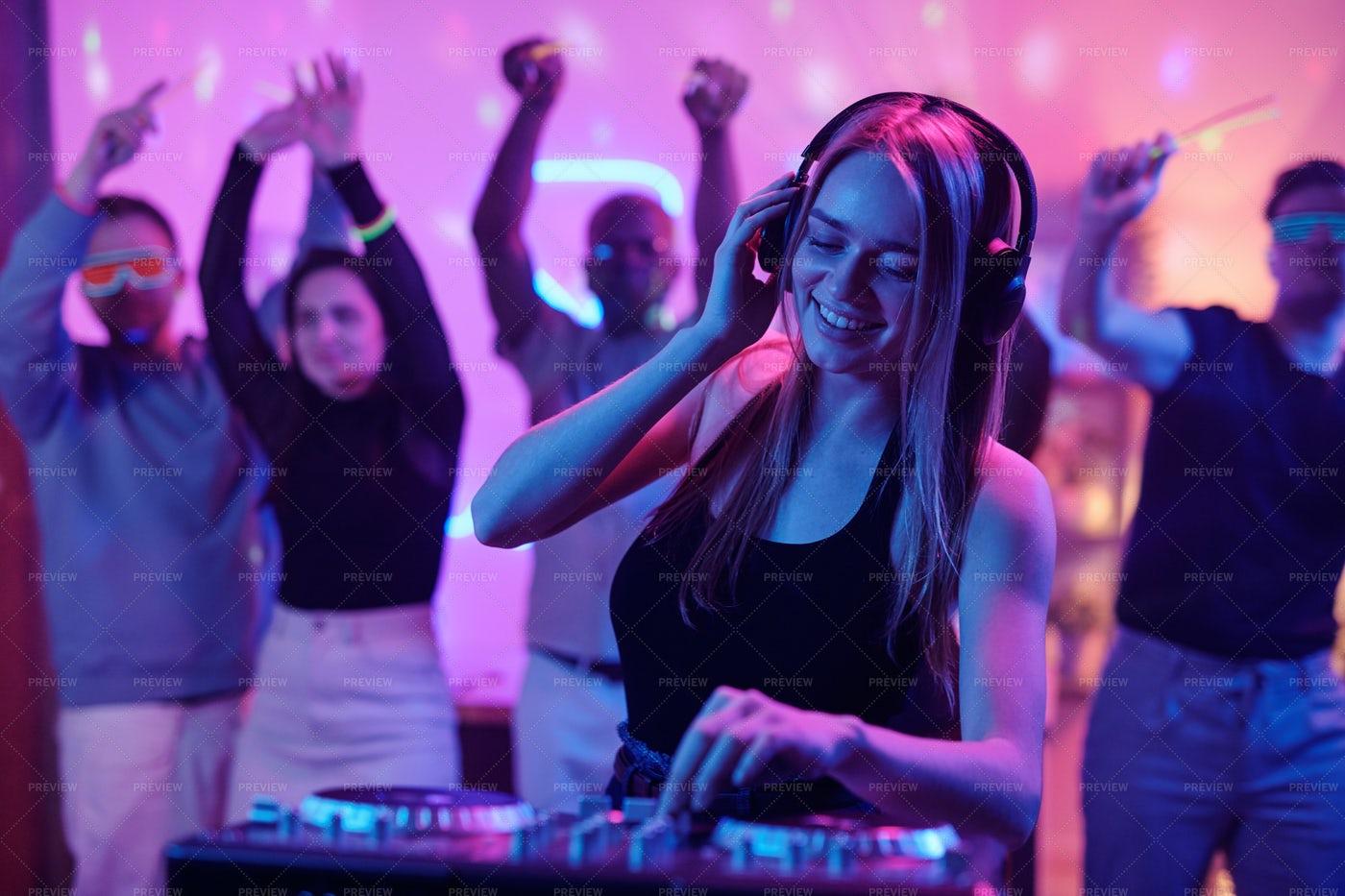 Girl With Long Blond Hair DJing: Stock Photos